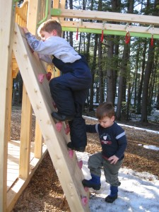 Nicholas and William climbing a wall!