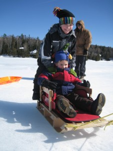 Nicholas and his cousin Ian zooming on the ice